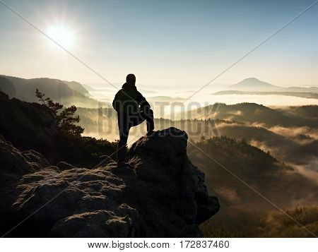 Man Silhouette Stay On Sharp Rock Peak. Satisfy Hiker Enjoy View.