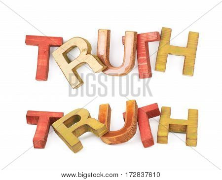 Word Truth made of colored with paint wooden letters, composition isolated over the white background, set of two different foreshortenings