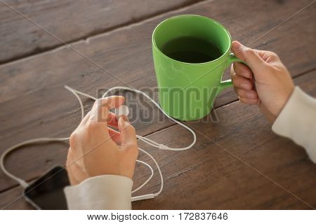 Woman hand on hot green tea drinking stock photo
