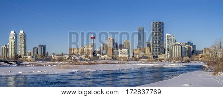 CALGARY, CANADA - FEB 11: Calgary downtown as viewed from the East Village along the Bow River on February 11, 2017 in Calgary, Alberta. The iconic Calgary Tower can be seen in the background.