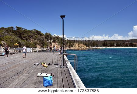 Tathra Australia - Jan 6 2017. Tathra Steamer Wharf. Its historic timbers standing proud and creating a focus for visitors. It is the only remaining sea wharf on the East Coast.