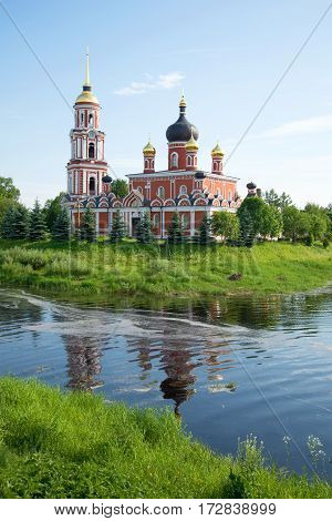 View of Resurrection Cathedral on the river bank Polist in the sunny June afternoon. Staraya Russa, Russia