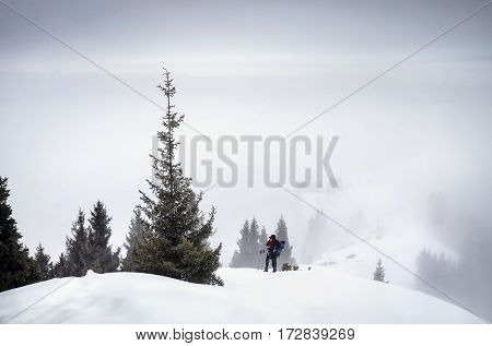 Photographer In The Snowy Mountains