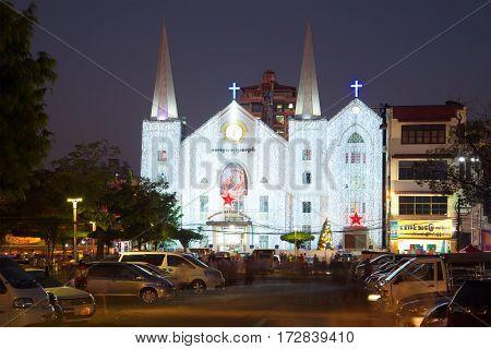 YANGON, MYANMAR - DECEMBER 18, 2016: Baptist Church of Immanuel in the Christmas illuminations in the evening twilight