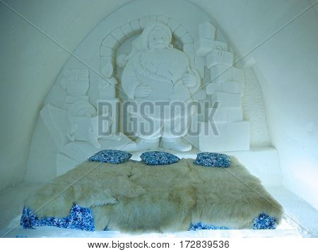 KEMI, FINLAND - FEBRUARY 18, 2017:Unique beautifully decorated Santa Claus snow suite in Snow Hotel at LumiLinna Snow Castle in Kemi, Finland. Snow Hotel is the World Luxury Hotel Global Award Winner