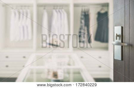 Opened Wooden Door To Closet Room With White Hat And Jewelry Set On A Table