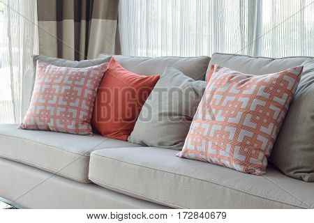 Chinese Style Pattern And Red Pillows On Gray Couch In Comfort Living Room