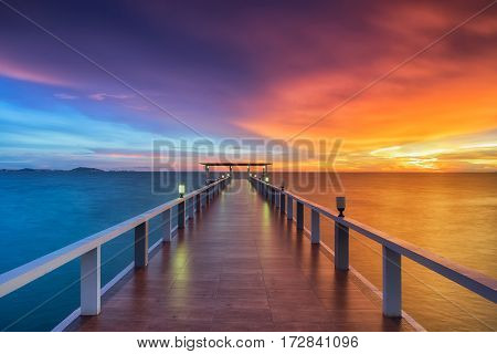 Summer Travel Vacation and Holiday concept - Wooden pier between sunset in Phuket Thailand.