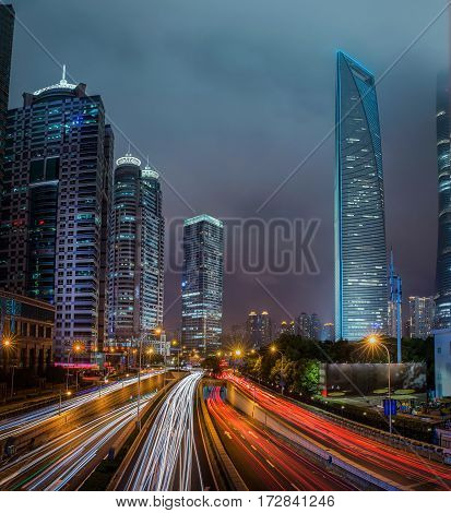 road in Shanghai lujiazui financial center with light and night time china