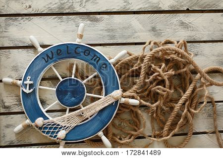 Steering wheel on old wood background. Skipper's wheel from an old ship.