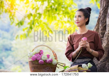 Asia women and lotus flower water lilly in vintage and country life style