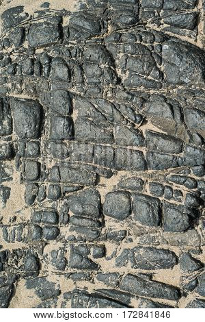 Volcanic rocks and sand