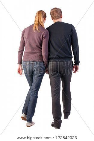 Back view of walking  young couple (man and woman). going beautiful friendly girl and guy in shorts together. Rear view people collection.  backside view of person.