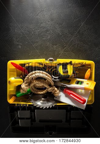 tools and instruments with toolbox  on black background