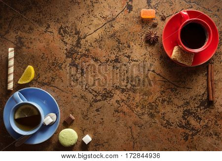 cup of coffee and tea on table background