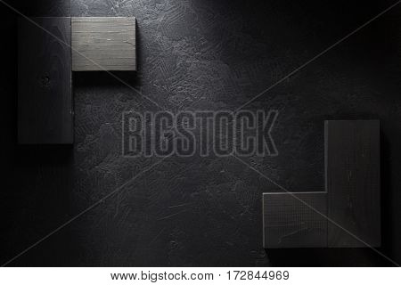wooden signboard at black background texture