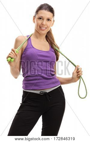 Female athlete posing with a skipping rope around her neck isolated on white background