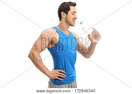 Sportsman drinking water from a bottle isolated on white background