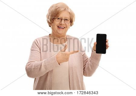 Mature lady holding a phone and pointing isolated on white background