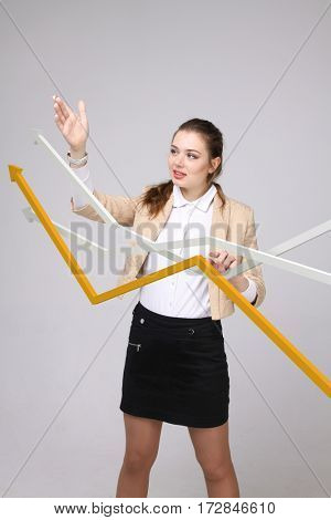 Businesswoman working with growth graph on grey background