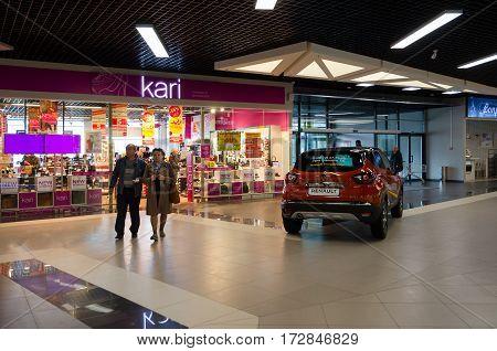 MOGILEV BELARUS - SEPTEMBER 27 2016: Unidentified people visit shop of footwear and accessories Kari in large shopping center Park City on Minsk highway Mogilev Belarus