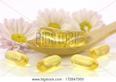 Soft Gelatin Capsules Of Dietary Supplement In Warm Light Tone.