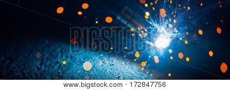 artistic welding sparks light, industrial background