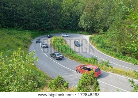 cars on hairpin turn mountain road in Montenegro