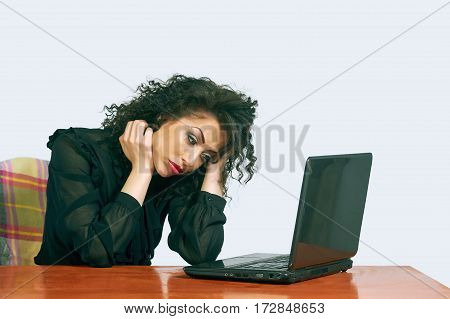tired woman sitting at the table after a hard day