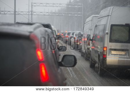 LENINGRAD REGION, RUSSIA - DECEMBER 13, 2014: Bad weather, traffic jam on the highway. Leningrad region, Russia