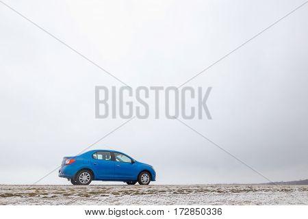 Gomel, Belarus - February 21, 2017: Car Renault - Logan Parked On The Roadside Slopes In The Winter.