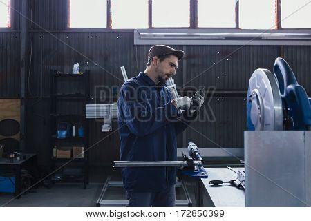 Serious craftsman looking at bike detail at workshop