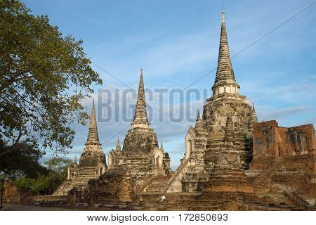 Three ancient stupas of the buddhist temple of Wat Phra Si Sanphet in the early morning. Ayutthaya, Thailand