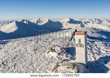 Trekking Poles Based On A Border Post.