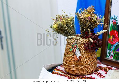 Clay Pot Covered With A Lid And Wheat Sheaf On The Background Fabric Pattern Ukrainian