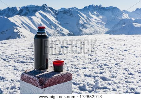 Boundary Stone Used As A Table For A Thermos Of Tea.