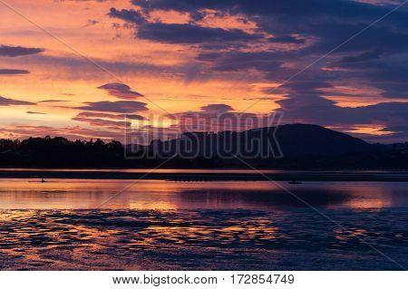 Intense sky colors sunrise across Tauranga harbour