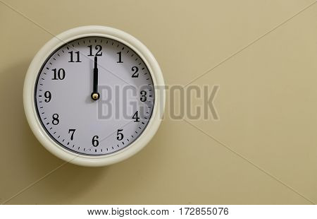 The time for wall clock is 12:00
