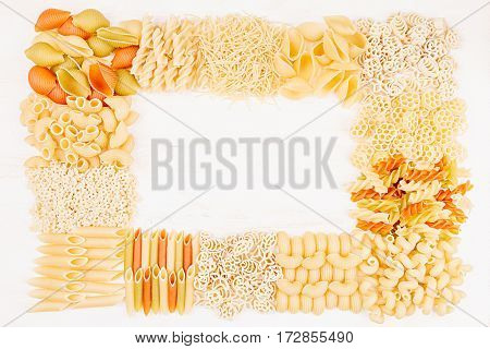 Pasta background decorative frame of assortment different kinds italian macaroni. Mock up restaurant menu.