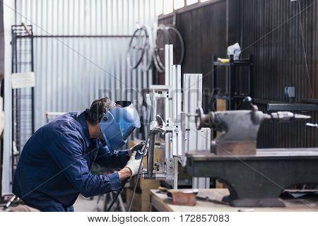 Professional craftsman welding detail for new bike