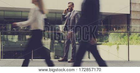Businessmen Calling Phone People Walk