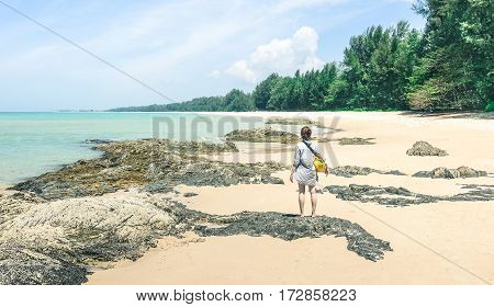 Young woman traveler with water bag enjoying sunny day at beach island hopping - Wanderlust travel concept with adventure girl tourist traveler on excursion in Thailand - Soft turquoise desat filter
