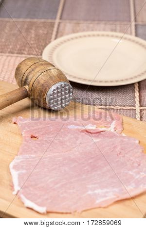 Old Retro Wooden Meat Hammer With Pork Chop On The Wooden Board