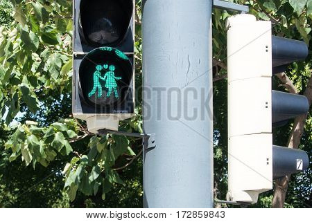 VIENNA AUSTRIA - JULY 29 2016: A close-up view of a green traffic light with an image of walking couple at the center of Vienna Austria.