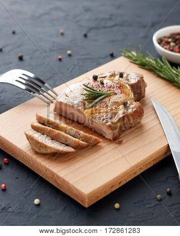 Homemade Roasted Pork Meat On Cutting Board With Cutlery, Herbs And Spices.