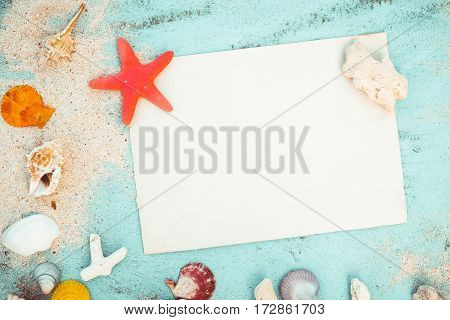 Summer background - Blank old paper with starfish shells coral on wood table background. vintage color tone styles.