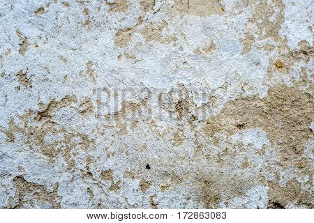 Texture of white antique plaster with covered with cracks and scratches