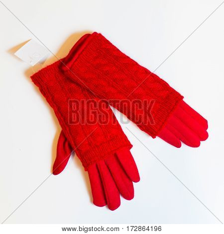 Red women's gloves warm on a white background