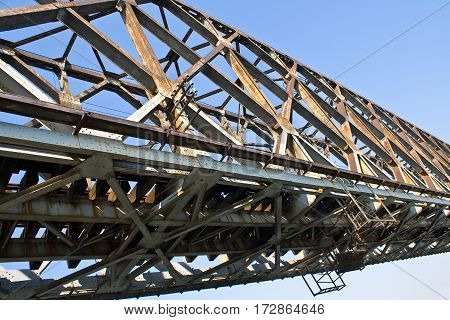 Old railway bridge over the blue sky