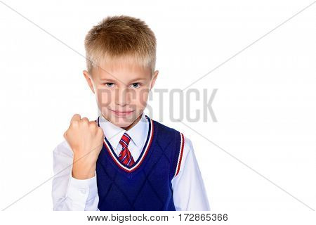 Serious schoolboy shows his fist at the camera. Isolated over white background. Educational concept. Copy space.